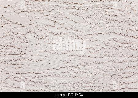 Mur extérieur en stuc blanc motif rugueux Banque D'Images