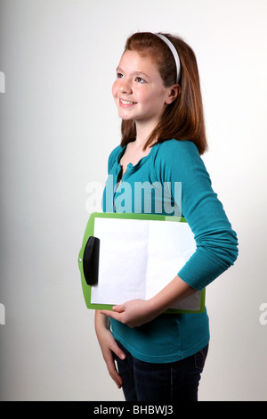 Studio shot of a Girl holding a clipboard Banque D'Images