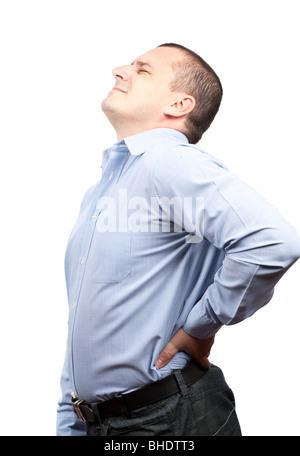 Jeune homme d'affaires avec une forte douleur au dos, isolé sur fond blanc Banque D'Images