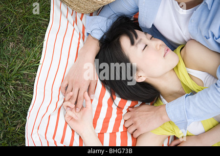 Couple on blanket Banque D'Images