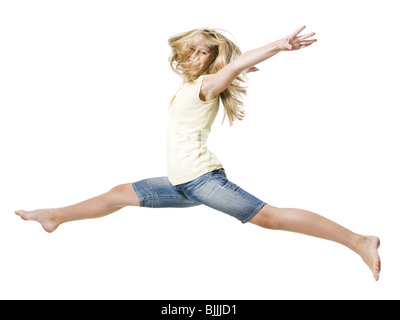 Girl leaping and smiling with arms up