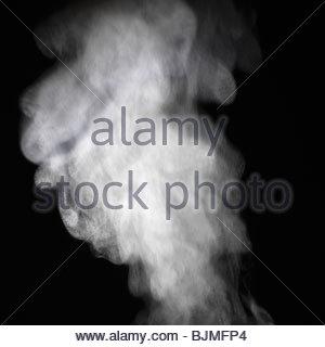 Machine à vapeur sur un fond noir Banque D'Images