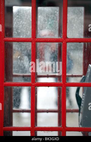 Détail d'une cabine téléphonique, rouge, Westminster, Londres. Banque D'Images