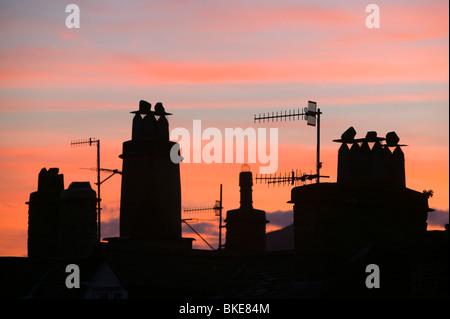 Coucher de soleil sur le lake district pots de cheminée à Ambleside UK Banque D'Images