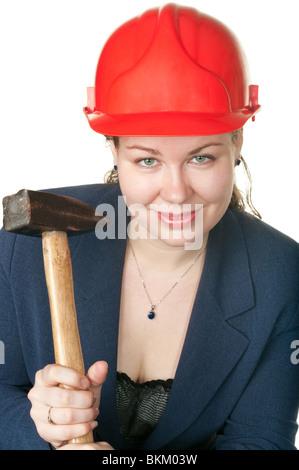 La belle jeune fille avec un marteau dans les mains. Il est isolé sur fond blanc Banque D'Images