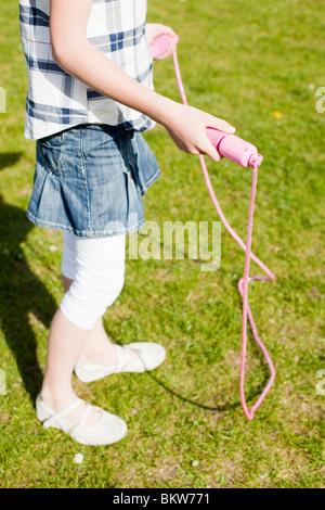 Fille avec la corde à sauter Banque D'Images