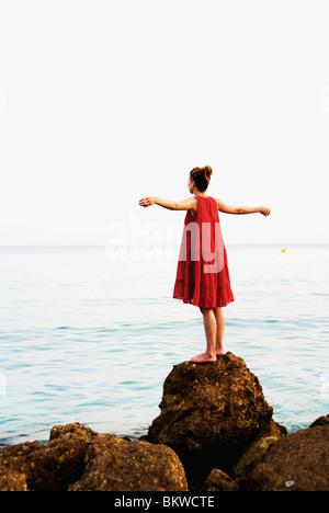 Femme en robe rouge Banque D'Images