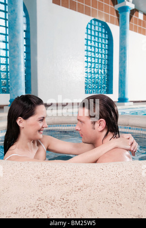 Couple romancing in a hot tub Banque D'Images
