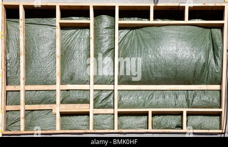 Bâche de protection murale inachevée at construction site Banque D'Images
