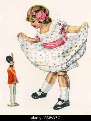 Jeune fille et le petit soldat de plomb Banque D'Images