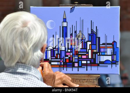 Un homme âgé de la peinture sur la rue à Venise, Italie Banque D'Images