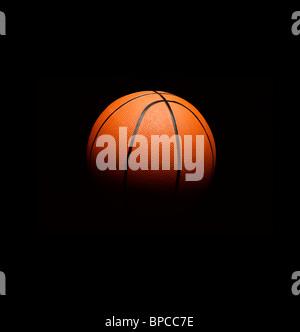 Basket-ball flottant dans l'espace Banque D'Images