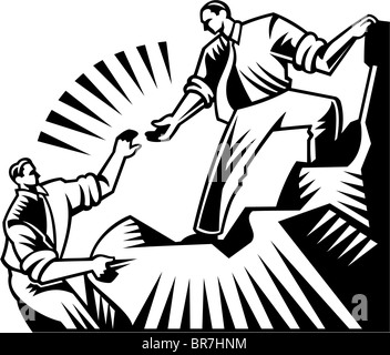 Un homme s'étend sa main pour aider un autre homme grimper une montagne Banque D'Images