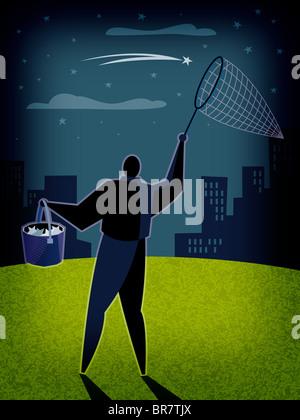 Un homme attrapant stars dans un filet Banque D'Images