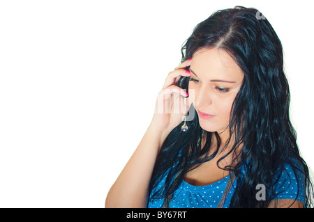 Closeup portrait of a beautiful young girl talking on mobile phone against white background Banque D'Images
