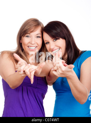 Deux jeunes femmes heureux souriant, faisant des gestes - isolated on white Banque D'Images