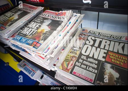 Les titres des journaux de New York sur une nouvelle position sur l'opération Odyssey Dawn en Libye