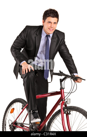 Un jeune businessman posing sur un vélo Banque D'Images