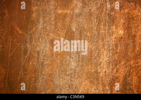 La photographie montre un fond de métal rouillé avec scrachted surface. Banque D'Images