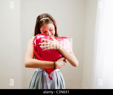 Ballon en forme de coeur Woman Banque D'Images