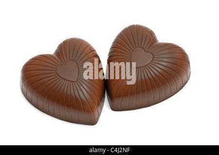 Vue d'oftop paire en forme de coeur chocolat bonbons isolated on white Banque D'Images