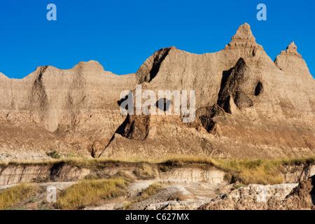 Tôt le matin, la lumière sur les formations rocheuses dans le Parc National de Badlands, dans le Dakota du Sud. Banque D'Images