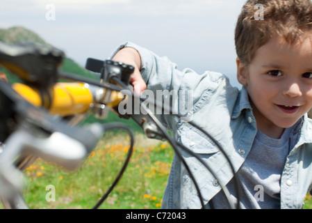 Boy riding bicycle, portrait