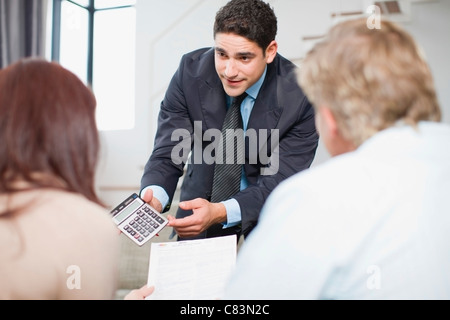 Businessman working with couple Banque D'Images