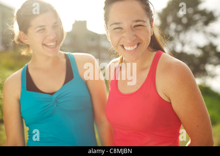 Athletic women smiling together outdoors Banque D'Images