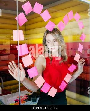 Faire affaires avec les notes du coeur Banque D'Images