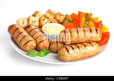 Saucisses de poulet avec pommes de terre SAUTE Banque D'Images