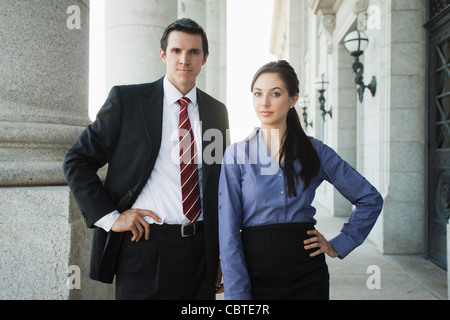 Caucasian business people standing outdoors Banque D'Images