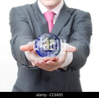 Businessman holding globe Banque D'Images