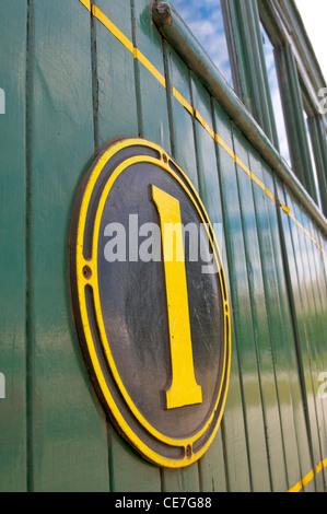 La première classe signe sur le train à vapeur Kingston Flyer en Nouvelle Zélande Banque D'Images