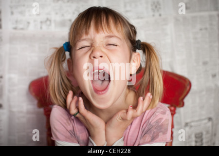 Portrait of Girl with pigtails laughing Banque D'Images
