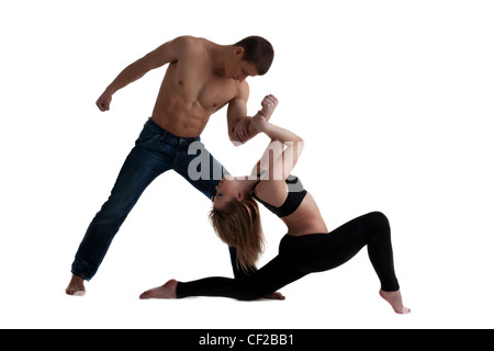 Couple de jeune gymnaste posing in dance performance isolated Banque D'Images