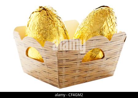 Deux oeufs en chocolat d'aluminium dans une boîte en carton plus facile punnett Banque D'Images