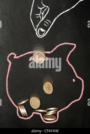 Dessiné à la craie part l'abandon du vrai livre des pièces de monnaie dans une tirelire dessiné à la craie Banque D'Images