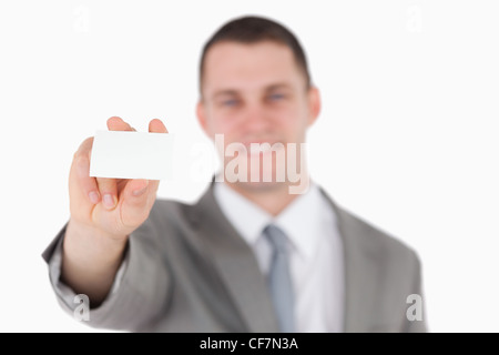 Businessman showing a blank business card Banque D'Images
