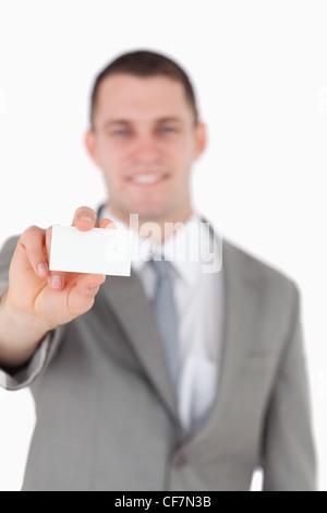 Portrait of a businessman showing a blank business card Banque D'Images