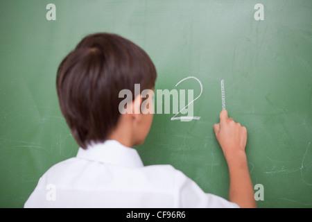 Outre l'écriture d'un écolier Banque D'Images