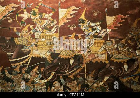 La Thaïlande, Phetchaburi, Wat Mahathat, mur des fresques murales représentant des scènes de bataille des éléphants Banque D'Images