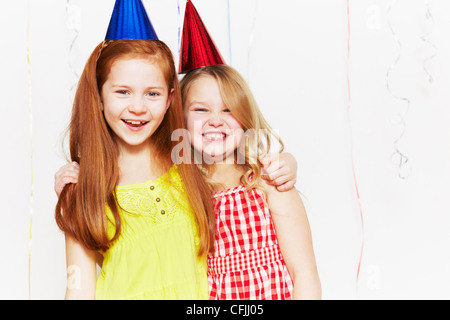 Happy in party hats Banque D'Images
