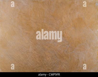 La texture grossière des murs recouverts de peinture marron avec des taches d'or Banque D'Images