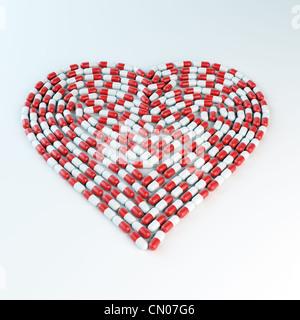 Gélules rouges et blanches formant une forme de coeur - concept cardiologie Banque D'Images