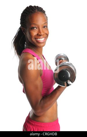 Belle African American Woman lifting dumbbells isolé sur fond blanc Banque D'Images