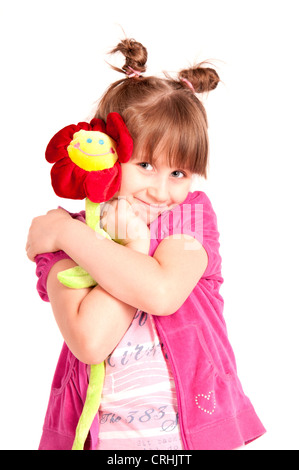 Little girl holding big red flower isolated on white. Banque D'Images