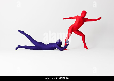 Couple in bodysuits posing together Banque D'Images