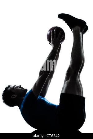 Un caucasian man exercising workout fitness ball holding en posture d'ossature studio isolé sur fond blanc Banque D'Images