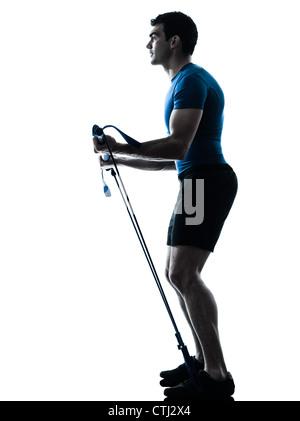 Un caucasian man exercising workout fitness à silhouette studio isolé sur fond blanc Banque D'Images